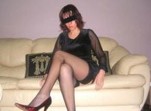 Jambes croisées en bas nylon - Femme chaude