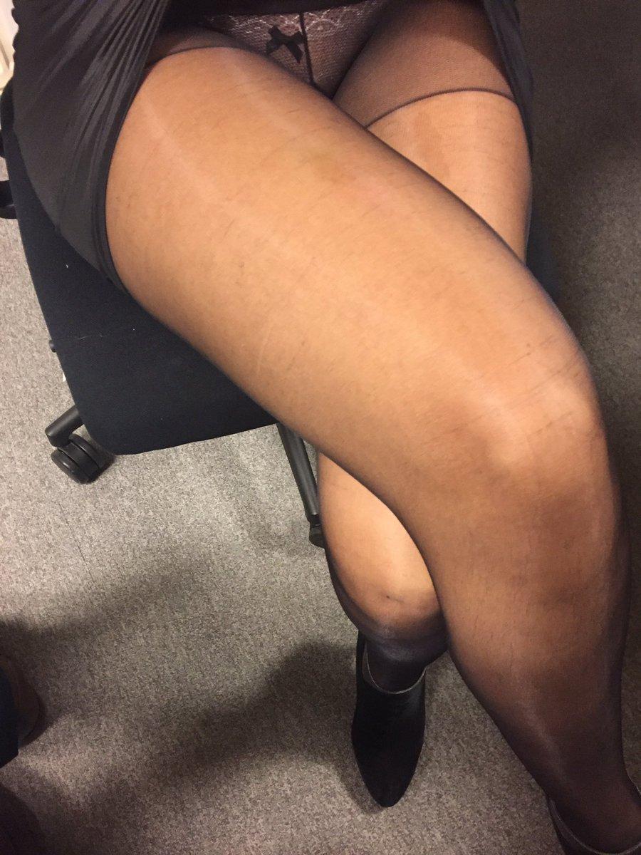 Jambes croisées en paire de collants